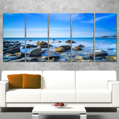 Designart Baratti Bay Rocks in Waters at Sunset Extra LargeSeashore Canvas Art - 4 Panels