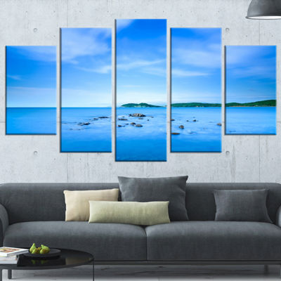 Designart Baratti Bay Small Rocks in Blue Sea Extra Large Seashore Wrapped Canvas Art - 5 Panels