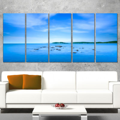 Designart Baratti Bay Small Rocks in Blue Sea Extra Large Seashore Canvas Art - 5 Panels
