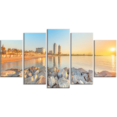 Designart Barceloneta Beach in Barcelona SeashorePhoto Canvas Art Print - 4 Panels