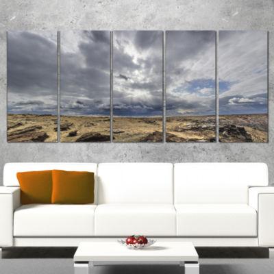 Designart Sky and Stones Under Dark Clouds Landscape ArtworkWrapped - 5 Panels