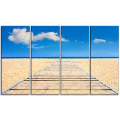 Designart Beach and Sea with Wooden Floor SeashoreCanvas Art Print - 4 Panels