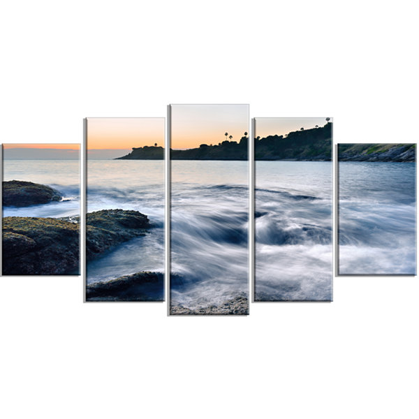 Designart Slow Motion Sea Waves Over Rocks ModernSeascape Wrapped Artwork - 5 Panels