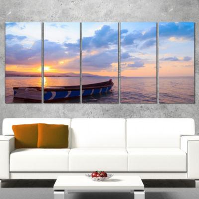 Designart Small Fishermen Boat at Sunset Modern Seashore Canvas Art - 4 Panels