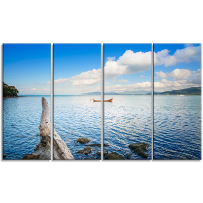 Designart Small Wooden Boat and Tree Trunk Extra Large Seashore Canvas Art - 4 Panels