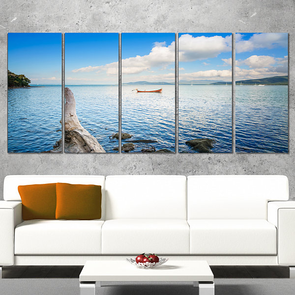 Designart Small Wooden Boat and Tree Trunk Extra Large Seashore Canvas Art - 5 Panels