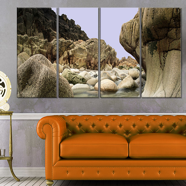 Designart Smooth Rocks in Coastline Panorama Landscape Canvas Art Print - 4 Panels