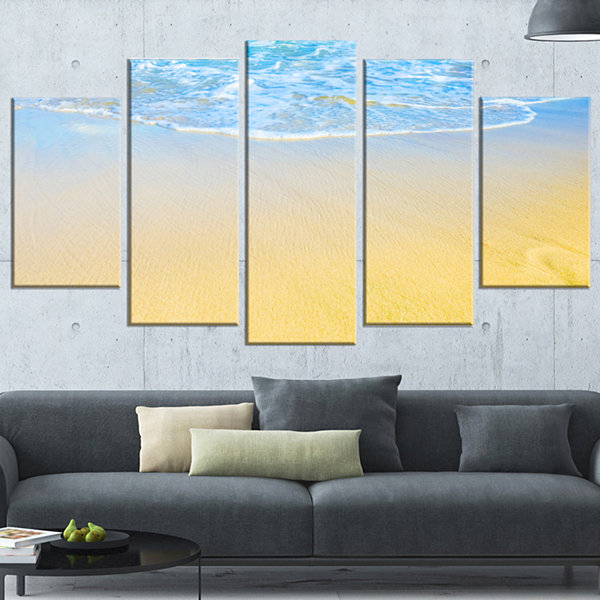 Designart Smooth Sea Surf Over Blue Waters Seashore WrappedArt Print - 5 Panels