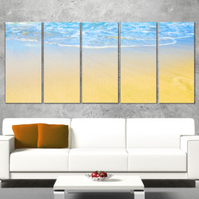 Designart Smooth Sea Surf Over Blue Waters Seashore Canvas Art Print - 5 Panels