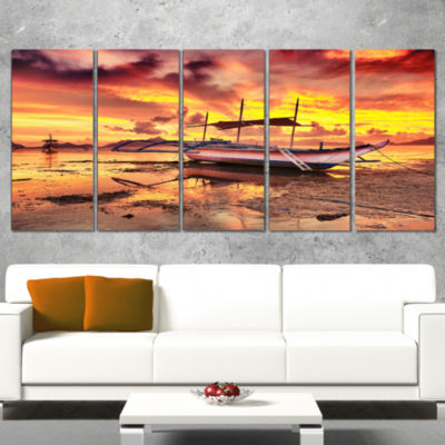 Designart Beautiful Boat Under Yellow Sky ModernSeashore Canvas Art - 5 Panels