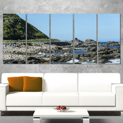 Designart Beautiful New Zealand Rocky Beach ModernSeascapeWrapped Canvas Artwork - 5 Panels