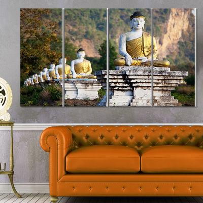 Designart Beautiful Row of Buddha Statues Oversized Landscape Canvas Art - 4 Panels