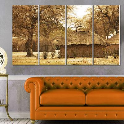 Designart Beautiful Rural African Huts OversizedLandscape Canvas Art - 4 Panels