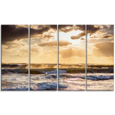 Designart Sunrise and Roaring Blue Sea Waves BeachPhoto Canvas Print - 4 Panels