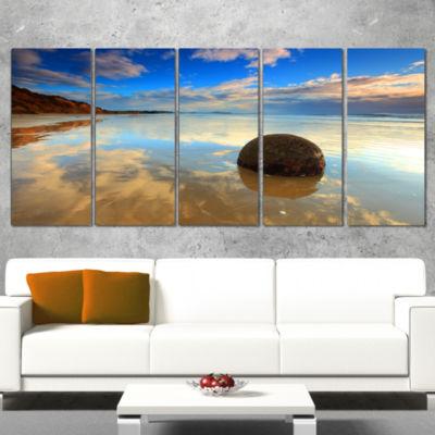 Designart Sunrise at Moeraki Boulders Seashore Photo CanvasArt Print - 4 Panels