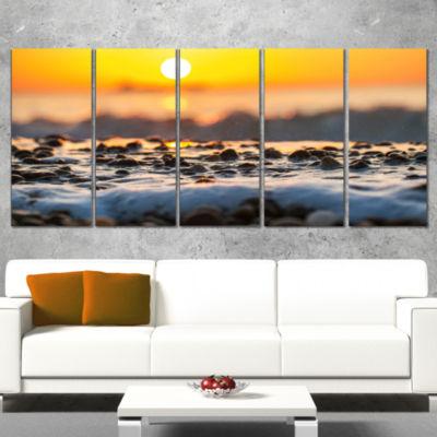 Designart Sunrise Giving Color For Sea Waters Seascape Canvas Art Print - 4 Panels