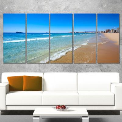 Designart Benidorm Poniente Beach Waves SeascapeWrapped Canvas Art Print - 5 Panels