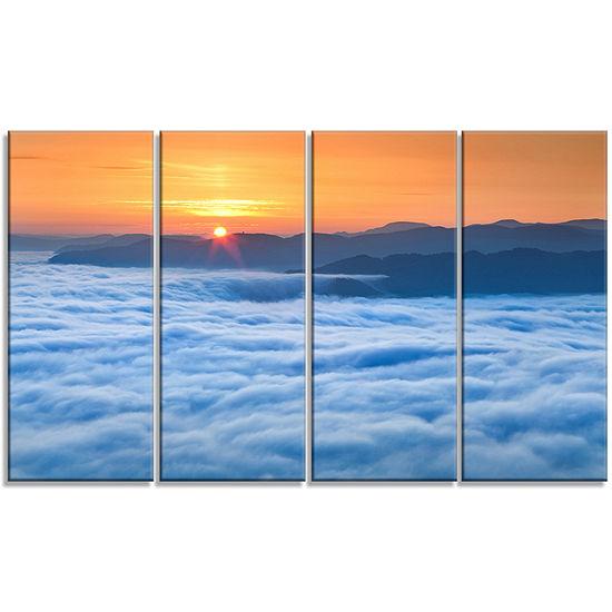 Designart Sunrise Over Misty Sea Waters LandscapePhotography Canvas Print - 4 Panels