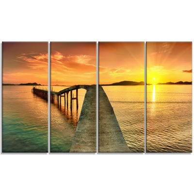 Designart Sunset Over Pier Panorama Photography Canvas Art Print - 4 Panels
