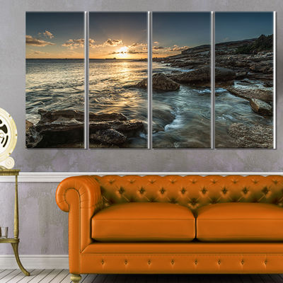 Designart Sydney Beach with Bright Sunset SeascapeCanvas Art Print - 4 Panels