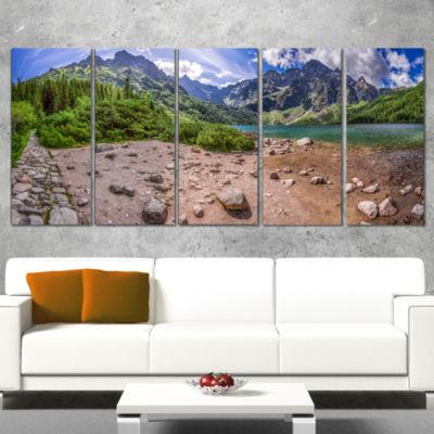 Designart Blue Lake Amid Mountains Panorama Landscape Canvas Art Print - 4 Panels
