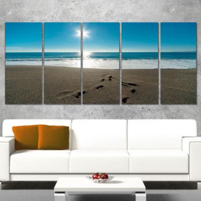 Designart Blue Sea and Footprints in Sand Large Seascape Art Canvas Print - 5 Panels