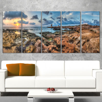 Designart Blue Sky Over Rough Rocky Coast Extra Large Seashore Wrapped Canvas Art - 5 Panels