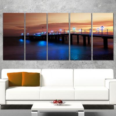 Designart Blue Waters and Bridge at Sunset Sea Bridge Wrapped Canvas Art Print - 5 Panels