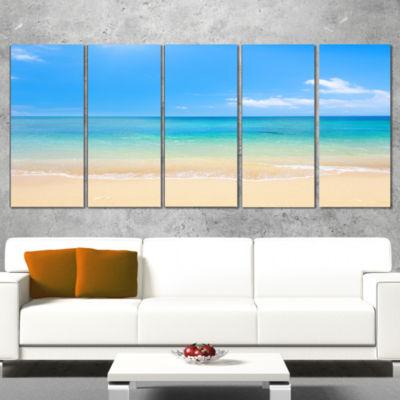 Designart Blue Waters Below Blue Sky Seashore Photo Canvas Print - 5 Panels