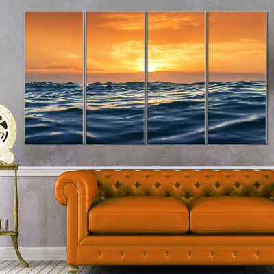 Blue Waves Dancing at Yellow Sunset Beach Photo Canvas Print - 4 Panels