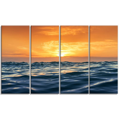Designart Blue Waves Dancing at Yellow Sunset Beach Photo Canvas Print - 4 Panels