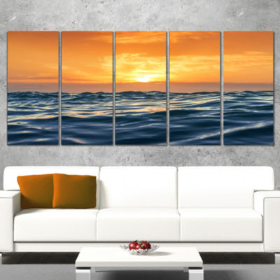 Designart Blue Waves Dancing at Yellow Sunset Beach Photo Wrapped Canvas Print - 5 Panels