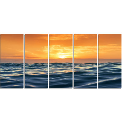 Designart Blue Waves Dancing at Yellow Sunset Beach Photo Canvas Print - 5 Panels