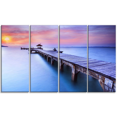 Designart Blue Wooden Bridge Seascape PhotographyCanvas Art Print - 4 Panels