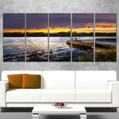 Designart Boat Docked in Lake at Sunset Modern Seashore Canvas Art - 4 Panels