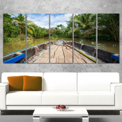 Designart Boat in Mekong River Vietnam OversizedLandscape Canvas Art - 4 Panels