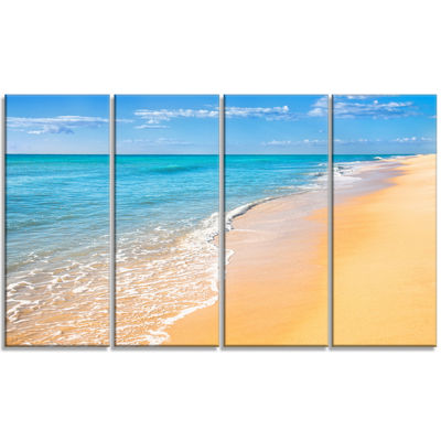 Designart Tropical Blue Sea and Sky Seashore PhotoCanvas Art Print - 4 Panels