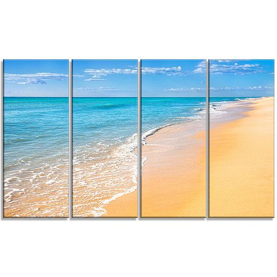 Designart Tropical Blue Sea and Sky Seashore PhotoCanvas Art Print - 4 Panels