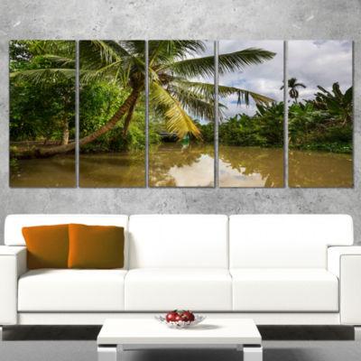 Designart Tropical River with Bent Coconut Palm Oversized Landscape Wrapped Art - 5 Panels