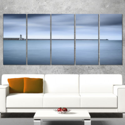 Designart Breakwater and Soft Water Under CloudsOversized Landscape Wall Art Print - 5 Panels