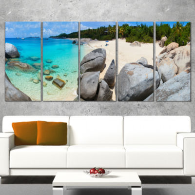 Designart Turquoise Ocean Water with Rocks ModernSeascape Canvas Artwork - 4 Panels