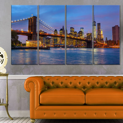 Designart Brooklyn Bridge with Lights and Reflections Cityscape Canvas Print - 4 Panels