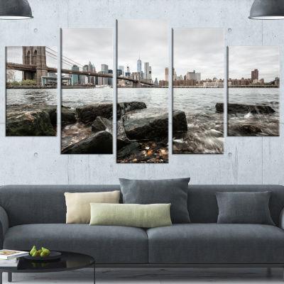 Designart Brooklyn Bridge with Rocks On Shore Large Cityscape Canvas Art Print - 5 Panels