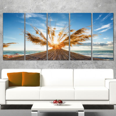 Designart Vivid Sunrise on Sandy Beach Seascape Canvas Art Print - 5 Panels