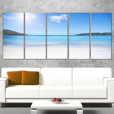 Designart Calm Beach of Azure Indian Ocean Seashore Canvas Art Print - 5 Panels