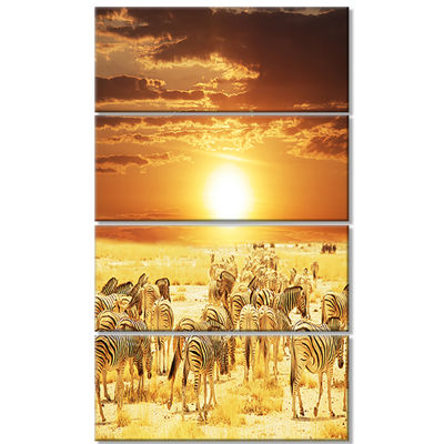 Designart Wandering Herd of Zebra at Sunset ExtraLarge African Canvas Art Print - 4 Panels