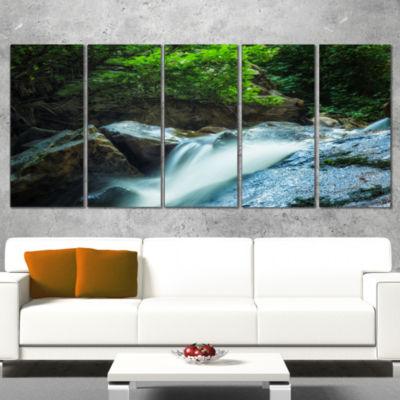 Designart Water Slide Over the Moss Landscape Canvas Art Print - 4 Panels