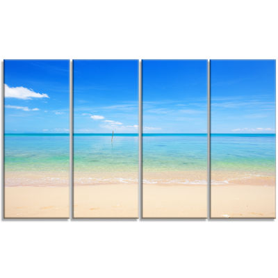 Designart Calm Waves at Tropical Beach Seashore Photo CanvasPrint - 4 Panels
