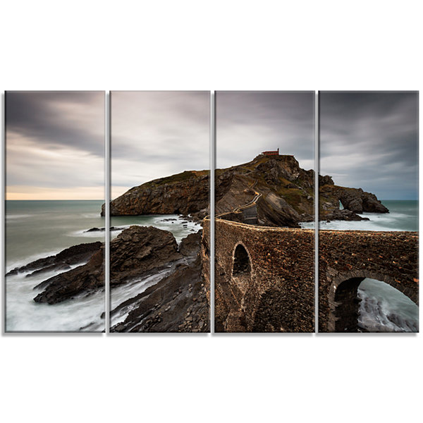 Designart Cape and Chapel in Spanish Beach Seashore Photo Canvas Print - 4 Panels
