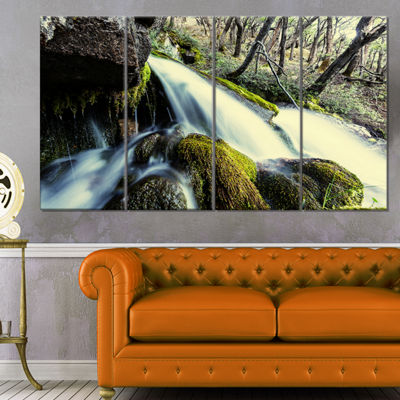 Designart Waterfall in Forest on Rocks Seashore Canvas Art Print - 4 Panels